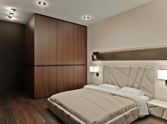 Темный дубовый интерьер комнаты и мягкость линий подсветки помещения создают уют.