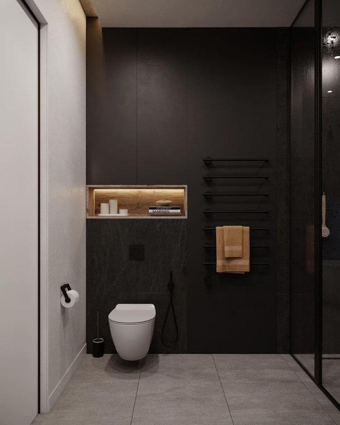 Электрический полотенце сушитель черного цвета в оттенок стен.