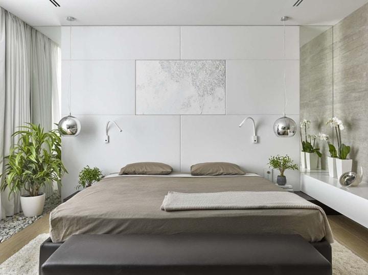Белый матовый мрамор со вставками - это еще один из вариантов современной спальни в стиле минимализм или хай тек. Как недостаток это отсутствие спинки кровати, что создает неудобство эксплуатации. Стена будет холодная и жесткая. Комфортно будет только спать.
