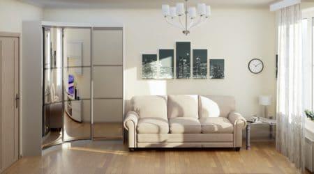 стильная гостиная с шкафом купе в углу и мягким диваном по центру