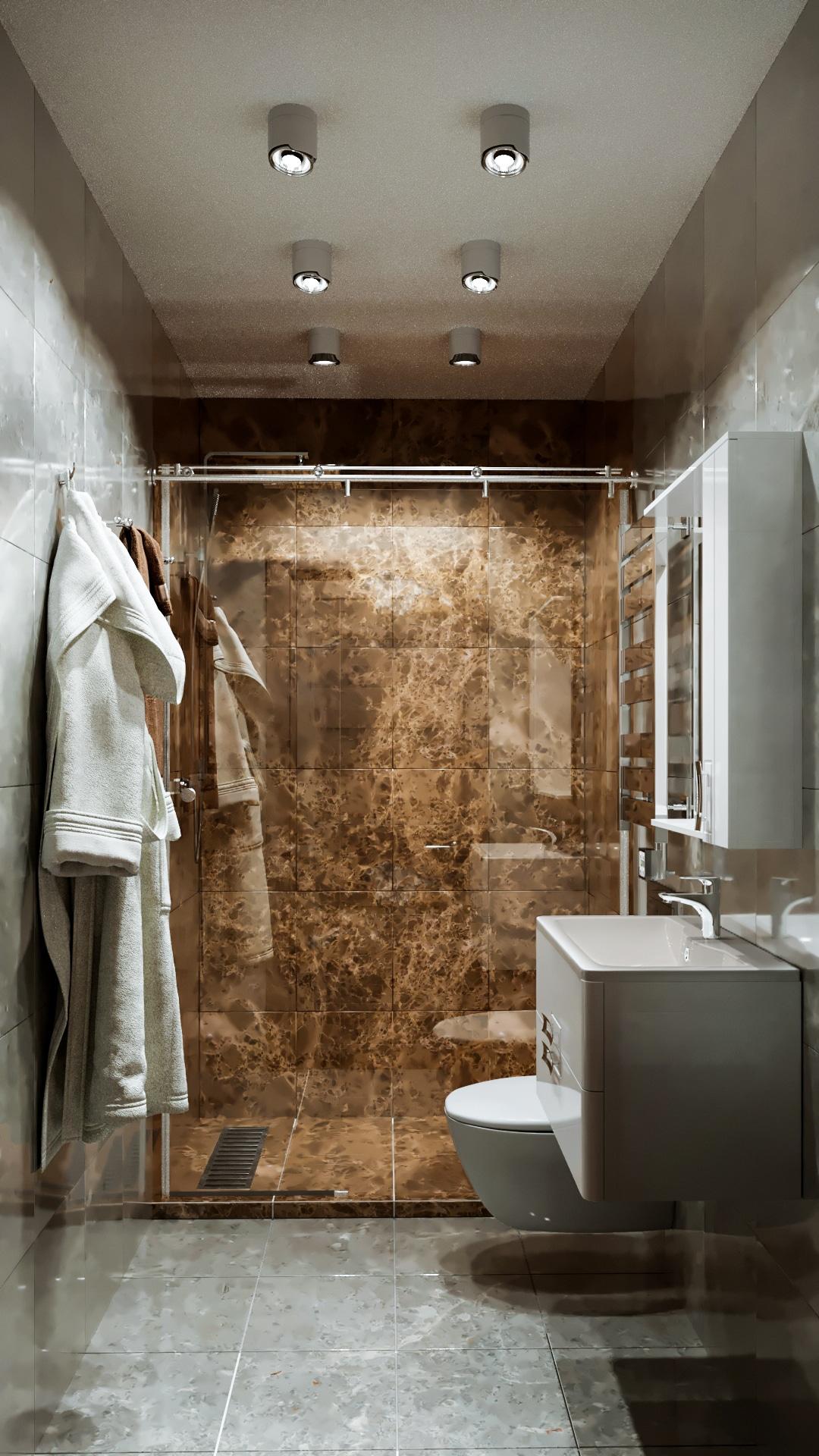 Вид сбоку на ванную в студии. Отделка плиткой под мрамор коричневого и белого цвета.