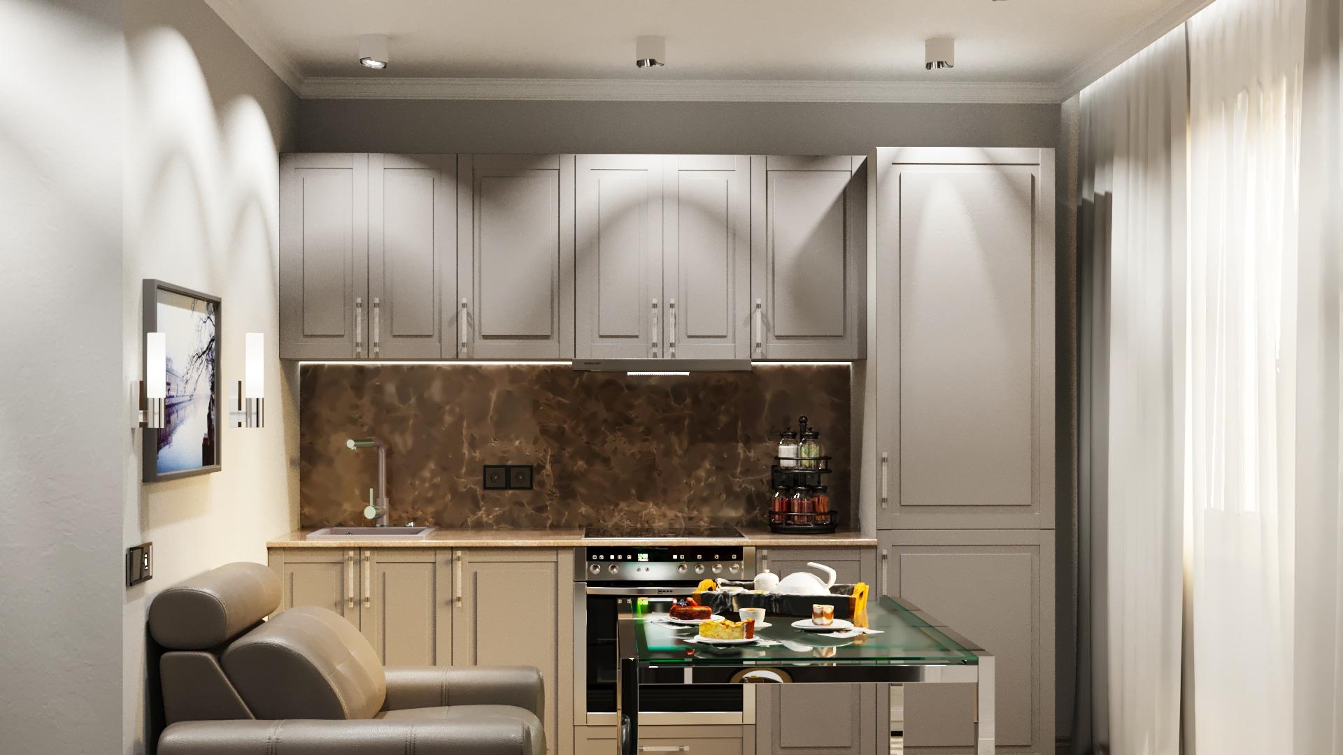 Вид на кухню. Серые фасады в классическом стиле. Спальное место для одного человека. Компактный кухонный стол из стекла и металла.