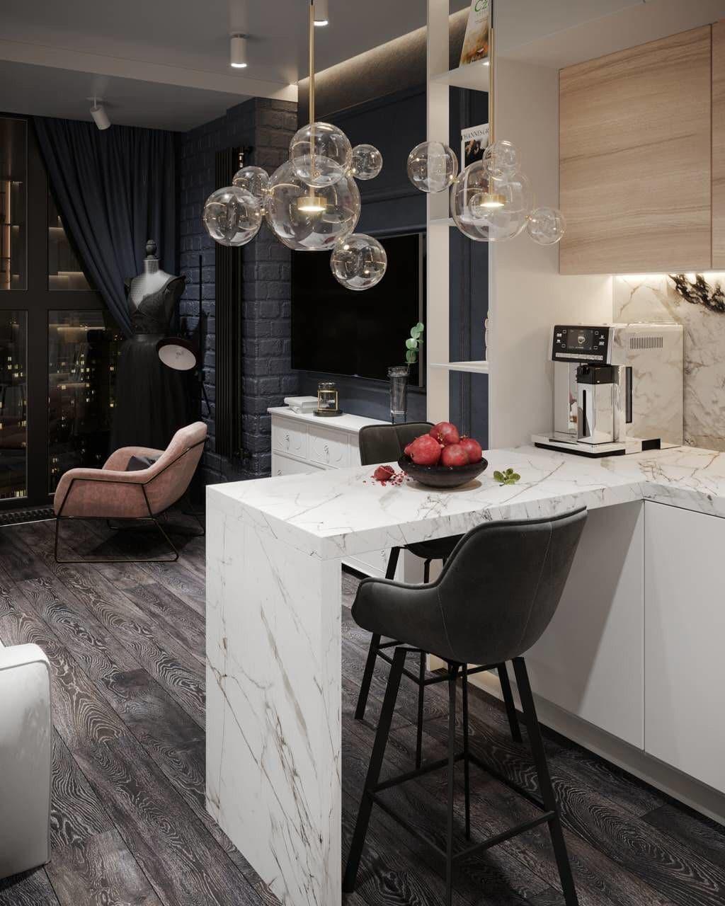Барная стойка из столешницы белого цвета. Дизайн проект студии 25 кв м в современном стиле.