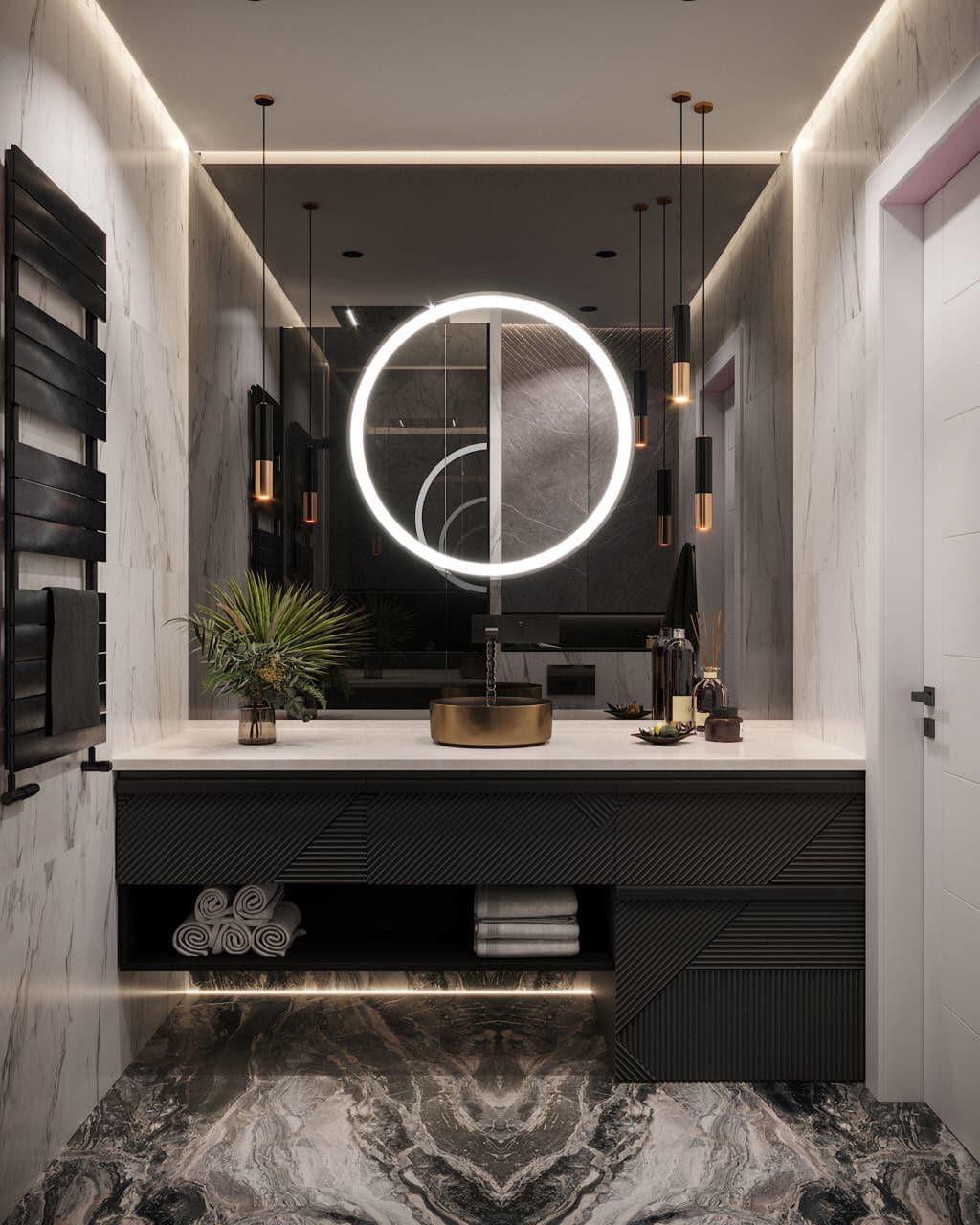 Зеркало с подсветкой в ванной комнате и облицовкой мрамором.