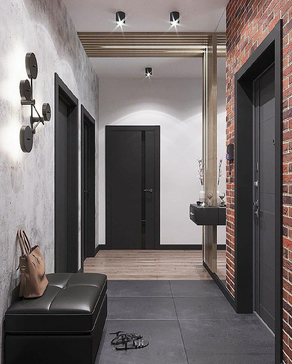 Лофт в интерьере с отделкой гипсовым кирпичом и рейками на потолке.